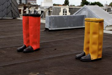 Yellow and red fire hose boots. High model.